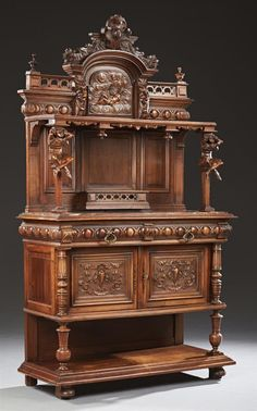 French Henri II Style Carved Walnut Marble Top Buffet a Deux Corps, late 19th century.