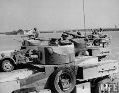 The squadron of armoured cars streaking across the desert after leaving Fort Rutbah, which they captured. Location:	Iraq Date taken:	1941 Photographer:	James Jarche
