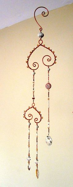 Beaded Wind Chimes Ideas - An elegant, subtle looking piece made of pure copper and strands of beads in cre. Wire Crafts, Bead Crafts, Diy Wind Chimes, Mobiles, Pure Copper, Gifts For Coworkers, Wire Art, Beads And Wire, Suncatchers