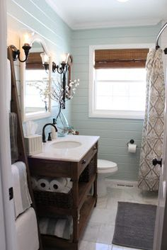Small Bathroom Chic: Expand Your Space with a Curved Shower Curtain Rod from Bathroom Bliss by Rotator Rod