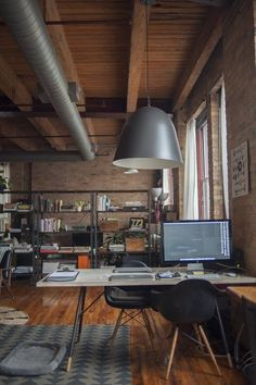 Office Space / Nicole & Mike's Warm Industrial Loft — House Call | Apartment Therapy