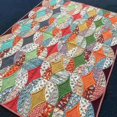 """This fun quilt made its way to NH and back! A colorful """"twist"""" on Metro Twist... haha! Get it! 😜 Beautifully quilted by my talented sister @helenonfabric #sewkindofwonderful #metrotwist"""