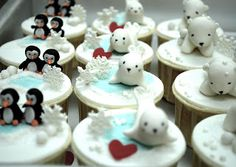 Adorably sweet penguin and baby seal winter cupcake toppers.