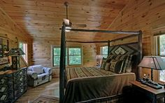 Awesome log canopy bed.  Beary Kozy with www.mountaintopcabinrentals.com