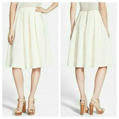 "NWOT Cream Textured Midi Skirt A tonal herringbone texture lends a polished, preppy vibe to a softly pleated midi skirt finished with a gleaming exposed zipper. Never worn! 26 1/2"" Length.   Waist measures 13 inches when laying flat and the fabric does have some stretch! S=4-6 Storee Skirts Midi"