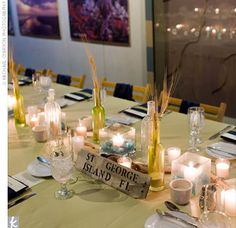 The Reception Decor - Nicki and Andy named each table after beaches, ranging from local favorites to some on the Australian coast, which they'd also visited together. A do-it-yourself project, they painted and distressed wood and then stenciled on the names with navy paint.