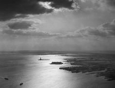 An aerial view of the Statue of Liberty in New York Harbor, on January 27, 1965. (Courtesy NYC Municipal Archives)  via theatlantic.com