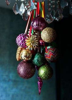 For an alternative decorating idea with baubles, hang a bunch of your favourites from a pendant light