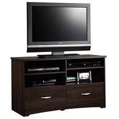 """Pemberly Row TV Stand in Cinnamon Cherry. Features: Cinnamon Cherry finish Two adjustable shelves hold audio/video equipment Two drawers with metal runners and safety stops Enclosed back with cord access Quick and easy assembly with patented T-slot drawer system Specifications: Overall product dimensions: 24 1/8"""" H x 41 5/8"""" W x 16 1/8"""" D Accommodates up to a 46"""" TV weighing 95 lbs. or less."""