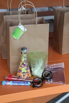 The beaker name tags came from the Dollar Tree. The candy beaker and glasses were bought after Halloween at 90% off. The geyser tubes, instant snow mix, and slime mix, was all ordered from Steve Spangler Science. They have tons of fun experiment ideas and supplies.