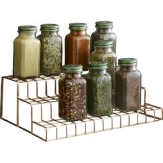 Corral spices and herbs above the kitchen counter with this essential stepper, featuring a copper-plated wire design.Product: ...