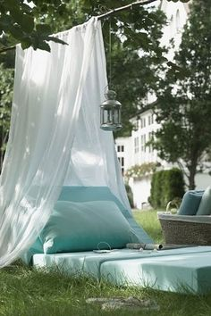 On a sunny day, take your living room outdoors, whether it's the entire sofa or a few cushions and throws. A voile canopy and a few lanterns strung from a tree will make it so much more than an impromptu picnic.