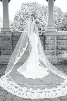 that is a pretty but very long veil i can just picture the husband trying to get it over her face it would take forever