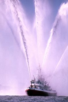 """""""Fireboat,"""" by Mike Jahn, via Flickr; A NYC fireboat greets the Parade of the Tall Ships to Op Sail '86 Statue of Liberty Centennial. Fire Dept, Fire Department, Purple Cars, Fleet Week, Cool Fire, Bizarre Pictures, Fire Equipment, Sailing Adventures, Fire Apparatus"""