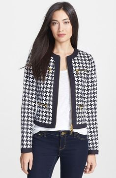 A crisp graphic print comprises a chic collarless jacket branded with gleaming golden hardware at the front zip placket and four front pockets