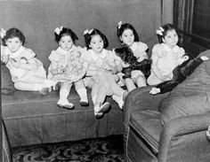 The Dionne quintuplets on a train trip, 1939   Library and Archives Canada/PA-122615