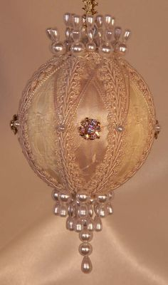 Victorian Ornament in pure ivory and gold, simple and pure, ivory brocade and a gold rhinestone button, swarovski crystals and Vintage Trims