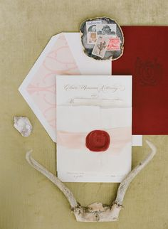 Crimson and blush pink wedding invitation suite with gold script, a red wax seal and gorgeous monogram details by Rock Paper Scissors. Image by Jen Fariello.