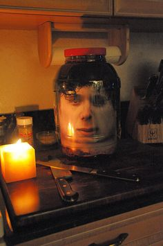 "Do a Google Search for a ""face texture map"". You want a photo-quality image of a sort of ""spread out"" face.    You can't simply print a photo of someone's face, because when you roll it up to fit it into the jar, it simply doesn't LOOK right."