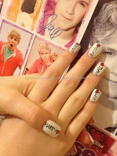 White acrylic nails with one direction freehand nail art