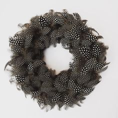 Polkadot guineafowl feather wreath www.pluckingfabulous.co.uk #Englishdesign #decoration #design #homedecor #handmade #feather #feathers #feather_perfection #gift #gifts #CountryHomes #interiors #countryliving #townandcountry #interiorideas #countrylife #guineafowl #featureluxuryinterior #interiordesign #interiordesigner #countryside #countrycottage #chic #style #englishhome #countryhome #spots #polkadot #blackandwhite