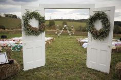 Create a welcoming entrance to the wedding ceremony with repurposed doors and green wreaths. #countrywedding http://www.gactv.com/gac/photos/article/0,3524,GAC_42725_6075192_01,00.html?soc=pinterest