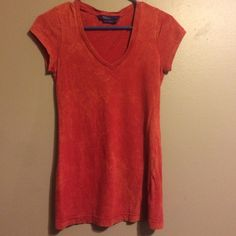 Reddish, orange v-neck Tight fitted. Worn a few times. Good condition. Tops Tees - Short Sleeve