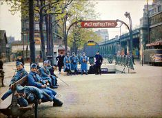 Soldiers hang out at the Exelmans métro stop. | 20 Mind-Blowing Color Pics Of Early 1900s Paris