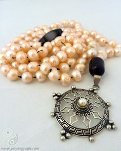 108 Cream Colored Freshwater Pearls enhanced by a Sterling Silver & Pearl Mandala