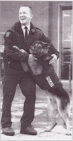 From the Edmonton Journal, November 6, 1999.   RCMP K9 Cst. MacKown and police dog Brit. Both had been injured in a shooting in August of the same year, and both were well on their way to recovery by the time this picture was taken.