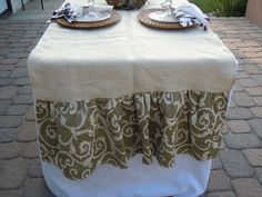 table runner that spans the entire width of the table - nice way to dress up white with less fabric