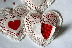 Lace hearts filled with cinnamon candies. Sew the edges with red thread. Fun to make and give.