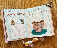 This tutorial shows how to create a mixed-media recipe journal and journal page using a repurposed box, watercolor paper, and mixed-media supplies.