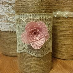 Hand wrapped twine bottles- sets of 3.  Flowers and lace can be easily changed.  Makes gorgeous centerpieces.
