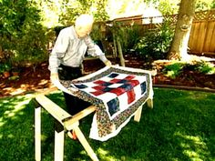 HGTV's Alex Anderson shows how to build your own diy quilt frame for under $50 using a saw horse in this step-by-step tutorial video.