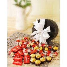 A decadent chocolate hamper containing a selection of imported chocolates including Lindt truffles, Bouchees, Ferrero Rocher & Mignonettes in a hat box.