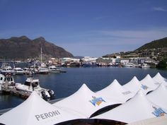 View from the Look-Out Deck Restaurant, Hout Bay Cape Town. Hout Bay is nearly like its own little republic within Cape Town. Peaceful, tranquil - a must visit when in Cape Town. Fishing Villages, Great Restaurants, Cape Town, South Africa, Deck, African, Ocean, Seafood Dishes, Fine Dining