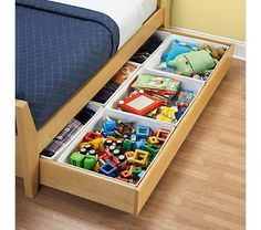 Kid's under the bed storage $14.95 at Land of Nod. Need to see if these would fit into the drawer of the Ikea bed.