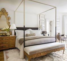 Bed and mirror, Tara Shaw Maison; 18th-century Swedish bench in a Kravet velvet. - Veranda.com