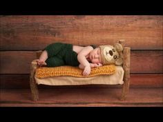 Portrait of a newborn baby boy wearing crocheted green overalls and bear hat. He is sleeping on a miniature wooden bed. Shot in the studio on a rustic wood background. by Katrina Elena, via Shutterstock Good Night Angel, Cable Knit Blankets, Rustic Wood Background, Newborn Crochet, Baby Center, Baby Boy Newborn, Baby Sleep, Child Sleep, Cribs