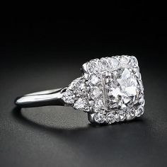 1930's vintage. [ oh my! I think this is the prettiest ring I've ver seen! I love the square center! and the vintage look! if anyone's looking for a ring for me ;) here it is! haha. ]