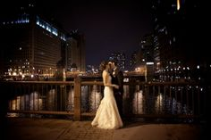 This photo from a Chicago wedding featured on EAD really caught my attention and I love it! Downtown Chicago at night.