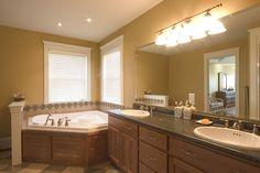 Custom designed vanity and jacuzzi tub.