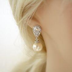 Pearl Jewelry Cream Ivory Pearl Cubic Zirconia Pearl Bridal Earrings Posts Silver with Swarovski Cream Pearls Wedding Jewelry. $34.00, via Etsy.