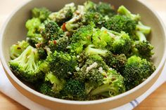 "Broccoli Salad With Garlic and Sesame Vinaigrette Recipe - NYT Cooking. The tangy sesame vinaigrette ""cooks"" the florets a little as ceviche does fish. The broccoli softens a bit, turns bright emerald, and soaks up all the intense flavors of the dressing."