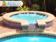 """Pearl Shallow 1b: The Pearl Shallow is a shallow version of the Pearl Spa and is perfect when used as a splash/kiddie pool. When it is incorporated beside an Aloha pool, it creates an elegant water feature. The Pearl Shallow is 7'6"""" round and is 8"""" deep.  For more information about Aloha Fiberglass Pools or to find a local pool builder in your area that can assist you, visit www.AlohaFiberglassPools.com or call (800) 786-2318."""