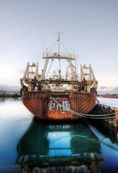 When I was in Iceland, I made a visit to the dock area. The edges of the dock were just beginning to freeze and occasional snow would blow in and pile up. All the ships were giant, metallic, and cold. I thought about what a hard life it would be to work on one of these ships. - Reykjavik, Iceland - Photo from #treyratcliff Trey Ratcliff at www.StuckInCustoms.com