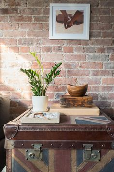 A beautiful Chinatown loft is given a grown-up redesign, taking it from bachelor pad to sophisticated home for this rad couple. A balance of masculine and feminine details keep it homey for both Chiara and Pedro and vignettes strategically cut up the open floor plan. Click through the slideshow for our designer Matthew's tips!