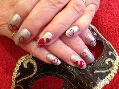 Silver hologram polish on acrylic nails with red freehand valentines love heart nail art