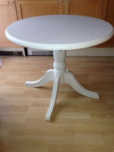4 seater pedestal dining table, painted white and protected with varnish